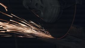 Man Works With Electric Grinder. Employee Works With Electric Grinder. Electric Tool Cuts Metal. Close-up stock video