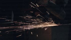 Man Works With Electric Grinder. Employee Works With Electric Grinder. Electric Tool Cuts Metal. Flying Sparks stock footage