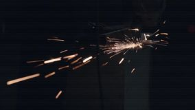 Man Works With Electric Grinder. Employee Works With Electric Grinder. Electric Tool Cuts Metal. Wonderful Flying Sparks stock video footage