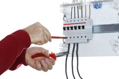 Man works on an electrical  junction. With white background Royalty Free Stock Photos