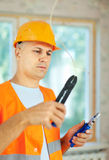 Man works with electrical wires Stock Photos