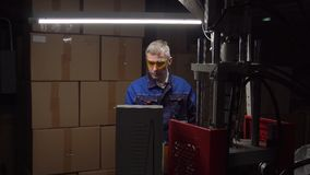 A man works in a factory stock video footage
