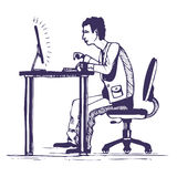 Man works hard on the computer Royalty Free Stock Photo