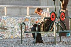 Man Works His Smartphone Sitting on Atlanta Beltline Bench Royalty Free Stock Photo