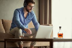 Man works at home at business project. Young man works at home at business project royalty free stock photo