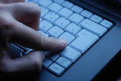 Man works on a laptop. Close-up shot Stock Images