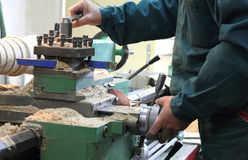 Man works in a lathe Stock Images
