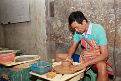 Man works on pottery wheel,Taibei,Taiwan. Royalty Free Stock Photo