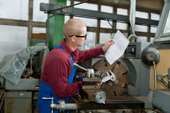 Man works for Production Machine Royalty Free Stock Photo