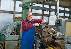 Man works for Production Machine Stock Photo