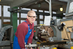 Man works for Production Machine Stock Photos