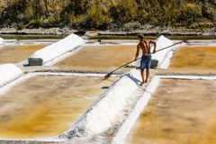 Man works salt extraction food industry. Baths with salt, in Vila real Santo Antonio, Portugal.  royalty free stock images