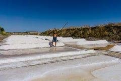 Man works salt extraction food industry. Baths with salt, in Vila real Santo Antonio, Portugal.  royalty free stock photo