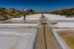 Man works salt extraction food industry. Baths with salt, in Vila real Santo Antonio, Portugal.  stock images