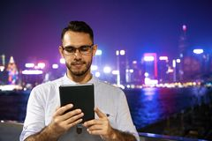 Man works tablet computer night big city royalty free stock photo