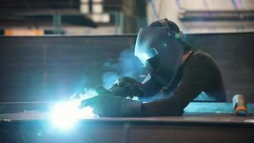 A man works with a welding machine - sparks fly stock video footage
