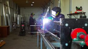 A man works by welding metal stock video footage