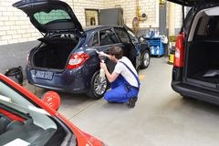 Man in a workshop cleaning a car - service for the customer. Closeup photo Stock Image