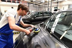Man in a workshop cleaning a car - service for the customer. Closeup photo Royalty Free Stock Photography
