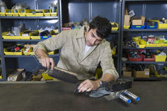 Man In Workshop With Tools Royalty Free Stock Photography