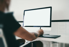 Man at workspace with generic design computer on Royalty Free Stock Photography