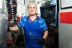 Man in workwear in auto mechanic workshop Stock Photo