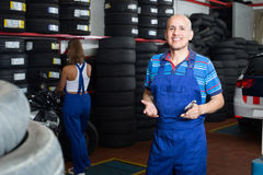 Man in workwear in auto mechanic workshop Royalty Free Stock Photography