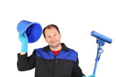 Man in workwear with bucket and mop. Stock Images