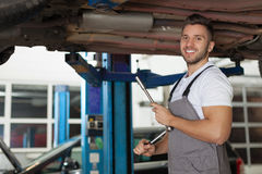 Man in workwear posing with a ratchet wrench Stock Photos