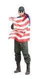 Man in workwear stands with american flag. Stock Images