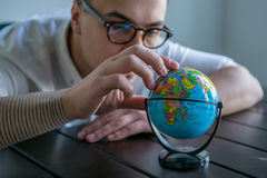 Man with world globe Royalty Free Stock Photo