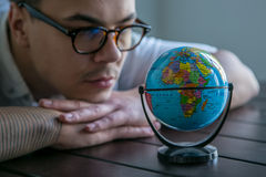 Man with world globe Stock Photos