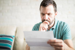 Man worried about his monthly payments Stock Image
