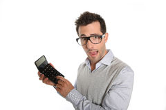 Man with worried look holding a calculator Royalty Free Stock Photography