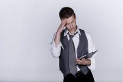 Man worried looking at clipboard, studio shot stock images