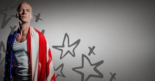 Man wrapped in american flag against grey background with hand drawn star pattern. Digital composite of Man wrapped in american flag against grey background with Royalty Free Stock Photo