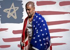 Man wrapped in american flag against hand drawn american flag and white wall. Digital composite of Man wrapped in american flag against hand drawn american flag Stock Photo