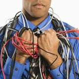 Man wrapped in cables. stock images