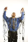 Man wrapped in cables. Royalty Free Stock Image