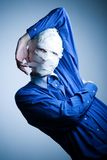Man wrapped in gauze. Man with face wrapped up in white gauze tape, caucasian/white Stock Image