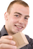 Man with a wrapped gift box Stock Photography
