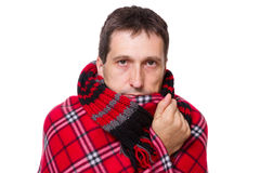 Man wrapped in a warm blanket Royalty Free Stock Photography
