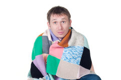 Man wrapped in a warm blanket shivering from the c Royalty Free Stock Photography