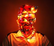Man wrapped in xmas lights Royalty Free Stock Image