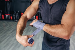 Man wrapping hands with bandages before boxing Stock Photography