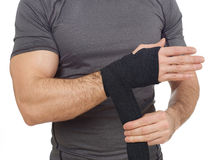 Man wrapping his wrist Stock Photo