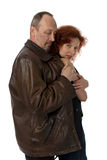 Man wrapping woman in coat stock photo