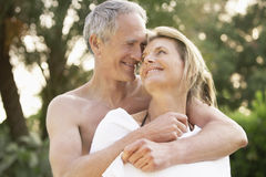 Man Wrapping Woman In Towel Royalty Free Stock Photos
