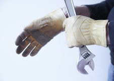 Man with wrench and gloves Stock Image