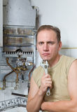 The man with a wrench thinks of repair of a gas wa Stock Photography